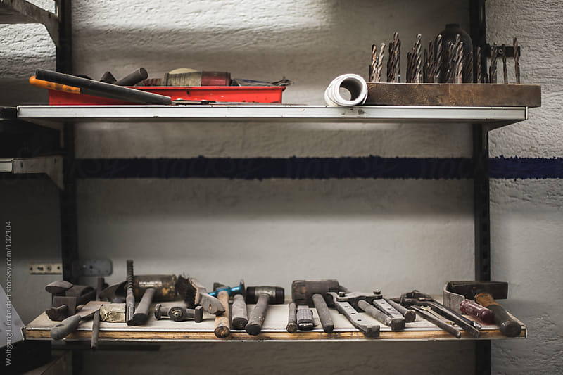 dusty set of old tools in a workshop by Wolfgang Lienbacher for Stocksy United