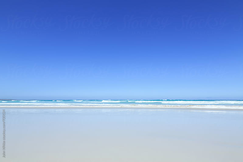 Remote beach with blue sky. Australia. by John White for Stocksy United