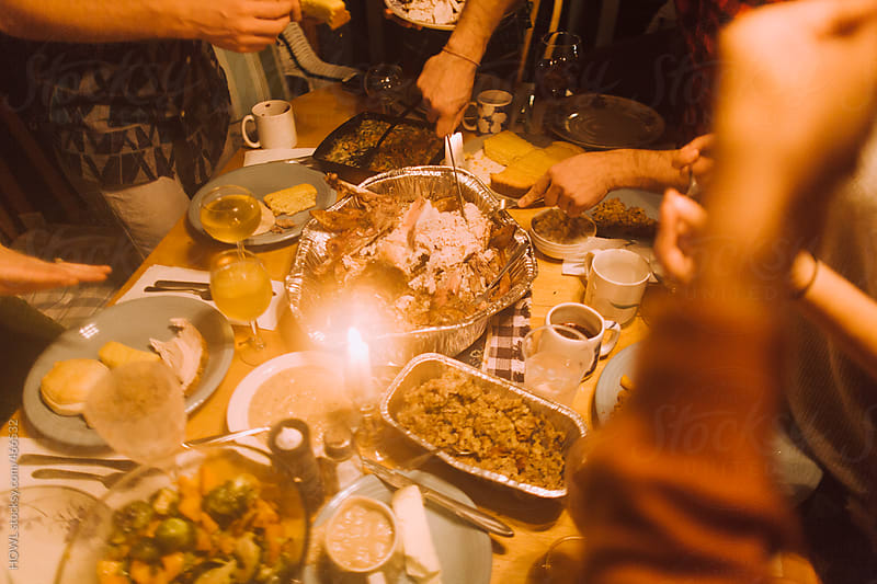 Friends enjoying a thanksgiving feast  by HOWL for Stocksy United