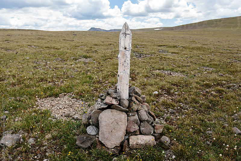 Trail marker on mountain path with missing sign by Matthew Spaulding for Stocksy United