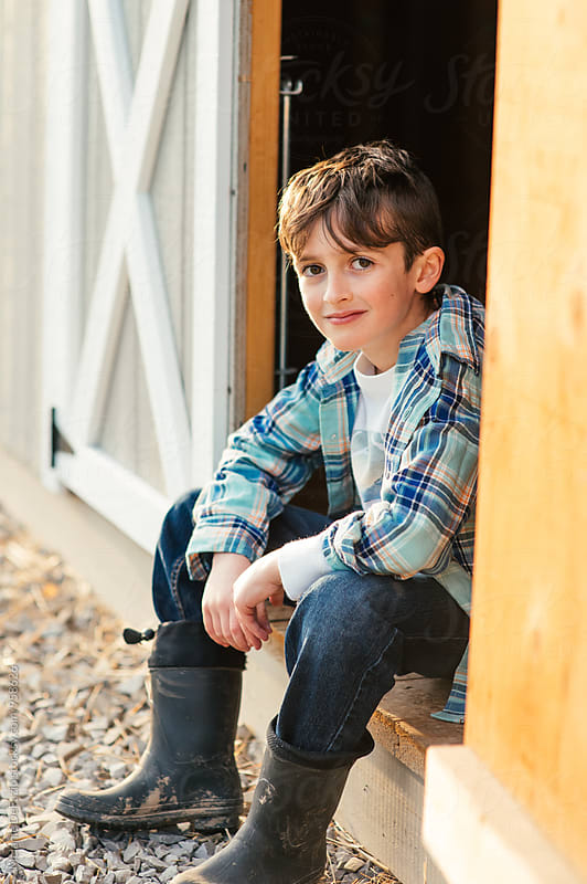 Farm boy by Melanie DeFazio for Stocksy United