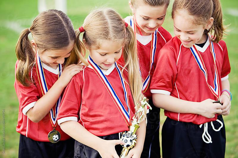 Soccer: Girl's Team Gets Trophy by Sean Locke for Stocksy United