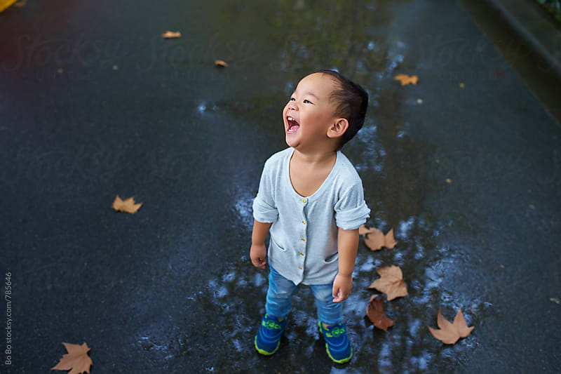 happy little asian boy smile in autumn day by Bo Bo for Stocksy United