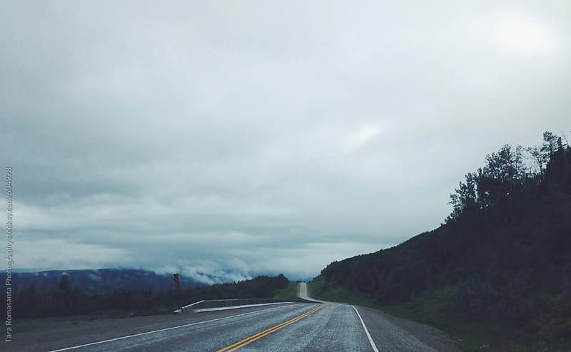 Moody overcast day on the open road by Tara Romasanta for Stocksy United