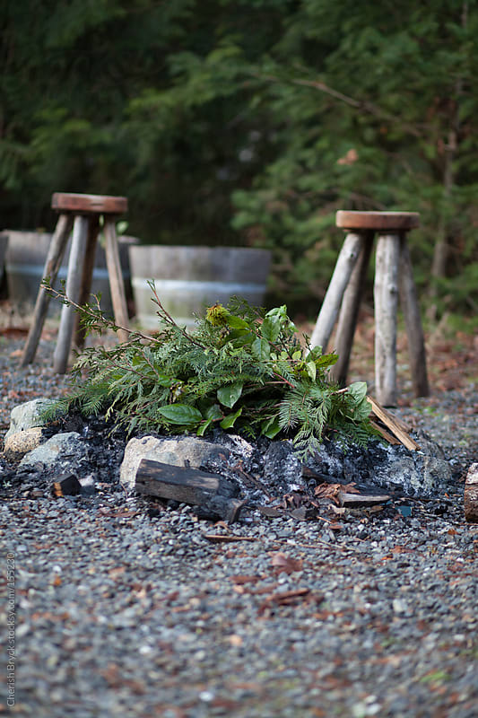 Fire pit is ready. by Cherish Bryck for Stocksy United