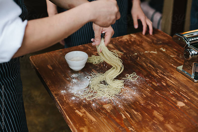 Chef Twirls Handmade Pasta Noodles by Grady Mitchell for Stocksy United
