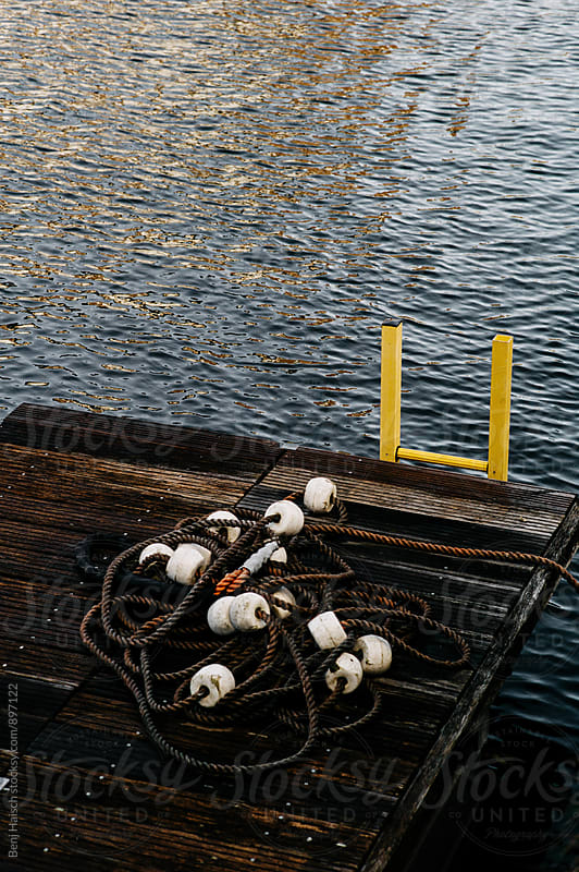 A Dock and Water. by Benj Haisch for Stocksy United