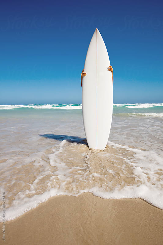 A surfboard on the beach. Australia. by John White for Stocksy United