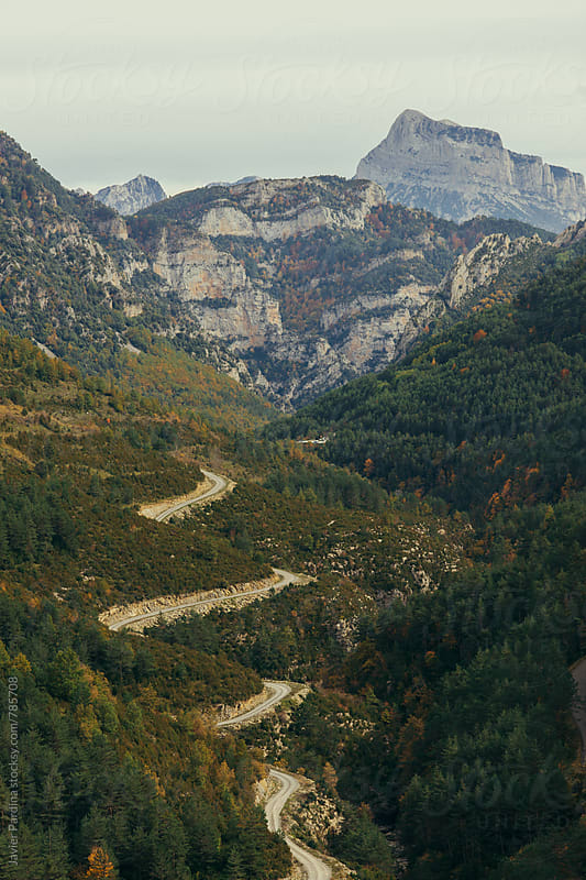 curve road in the mountains by Javier Pardina for Stocksy United