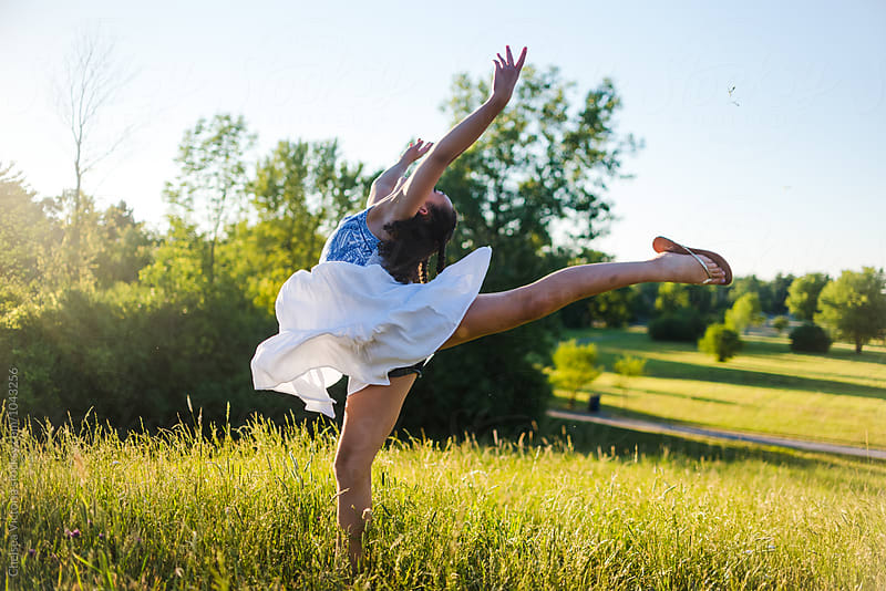 A beautiful young girl leaping in the air by Chelsea Victoria for Stocksy United