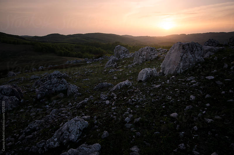 Sunset over rock formations at the mountain side by Cosma Andrei for Stocksy United