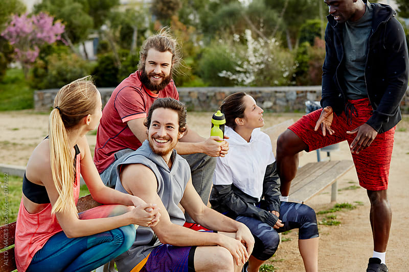 Athletes Relaxing After Workout In Park by ALTO IMAGES for Stocksy United