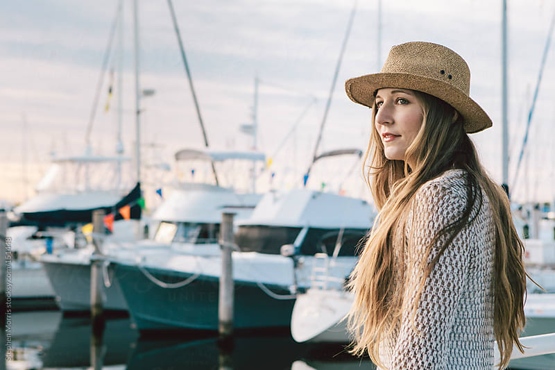 Profile of woman at marina by Stephen Morris for Stocksy United