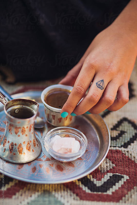 Woman drinking bosnian traditional coffee by Maja Topcagic for Stocksy United