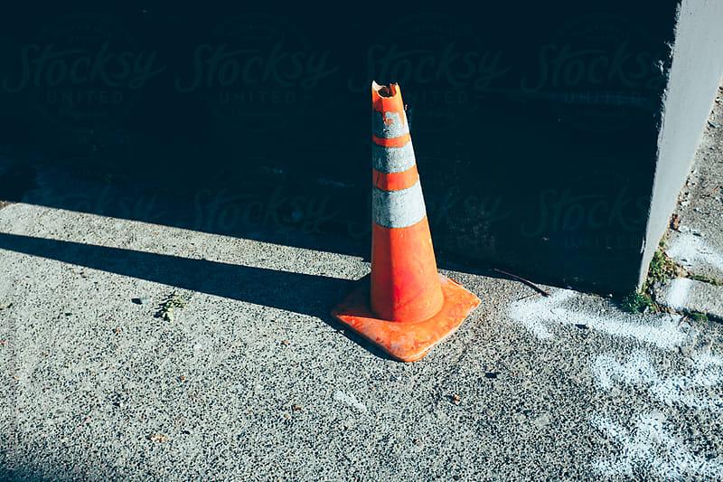 Traffic cone on urban street by Paul Edmondson for Stocksy United