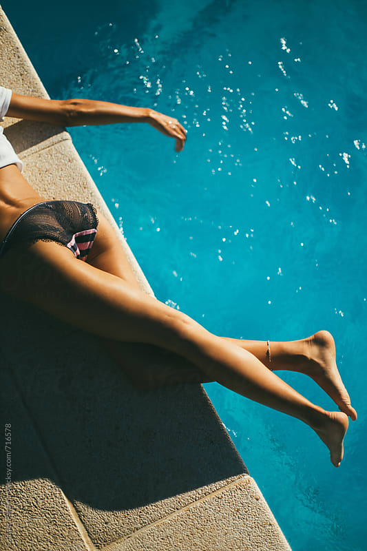 enjoying  the time near swimming pool by Javier Pardina for Stocksy United