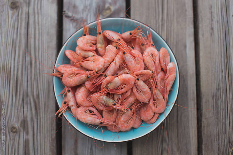Fresh shrimps in a bowl by Jonas Räfling for Stocksy United