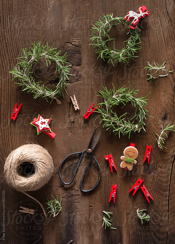 Christmas rosemary wreaths by Pixel Stories for Stocksy United