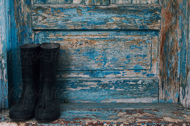 Rubber Welington boots on doorway by Pixel Stories for Stocksy United