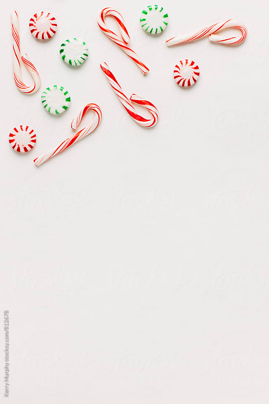 Peppermint candies from above on white by Kerry Murphy for Stocksy United