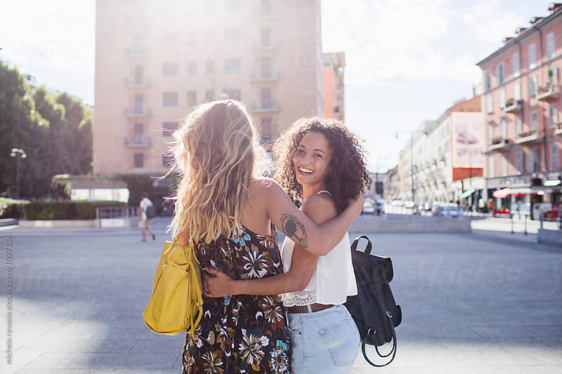 Affectionate female friends having fun in the city by michela ravasio for Stocksy United