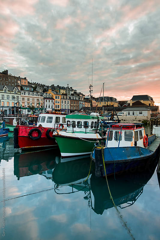 Blue, Red and Green Boat moored in Cobh by Gary Radler Photography for Stocksy United