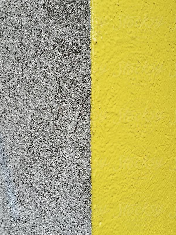 Detail of yellow building corner by Paul Edmondson for Stocksy United