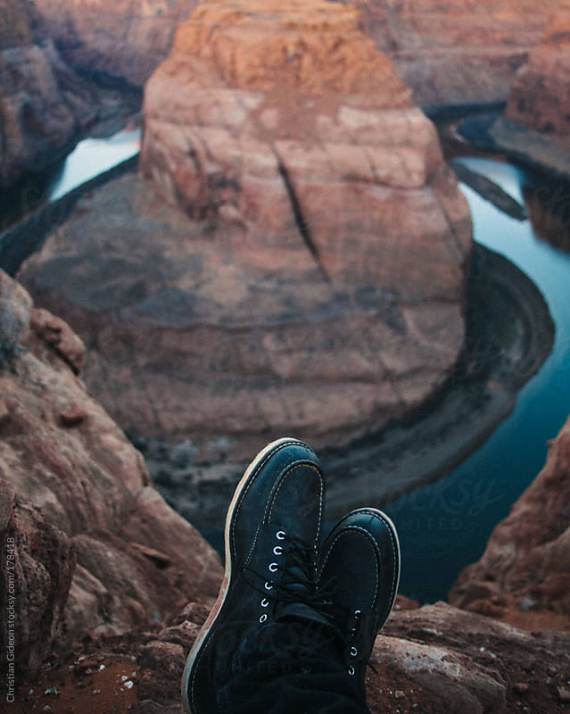 Dusty boots overlooking canyon by Christian Gideon for Stocksy United