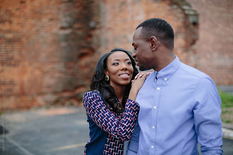 An African-American couple being affectionate in an urban setting by Jakob for Stocksy United