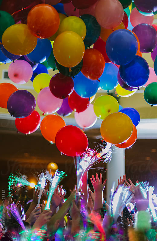 Balloons fall from the ceiling at New Year's Eve party. by Holly Clark for Stocksy United