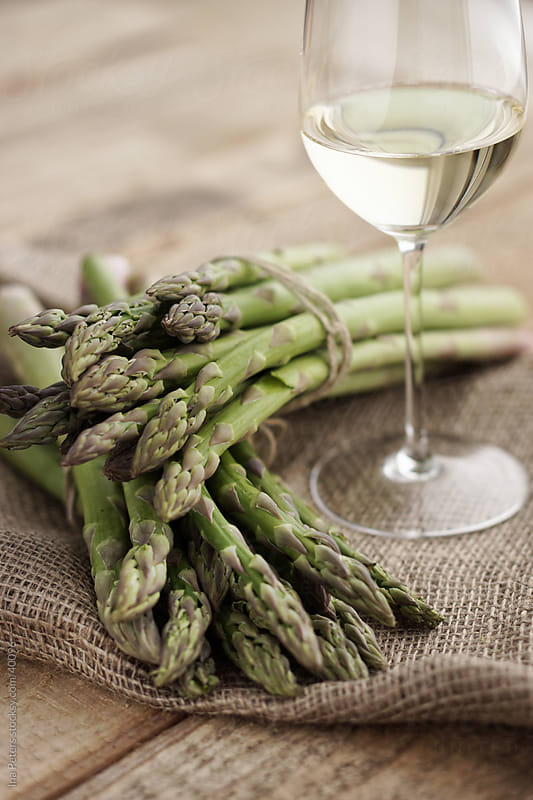 Food: green asparagus bundles by Ina Peters for Stocksy United