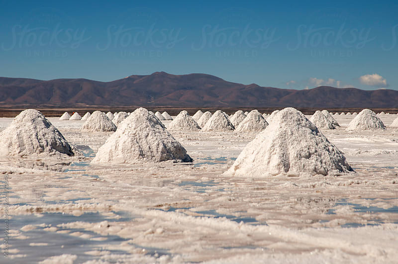Piles of salt being harvested in Bolivia. by Mike Marlowe for Stocksy United