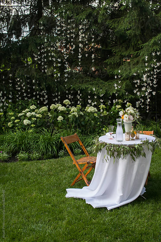 Paper Cranes with Table for Two at Outdoor Wedding by Anjali Pinto for Stocksy United