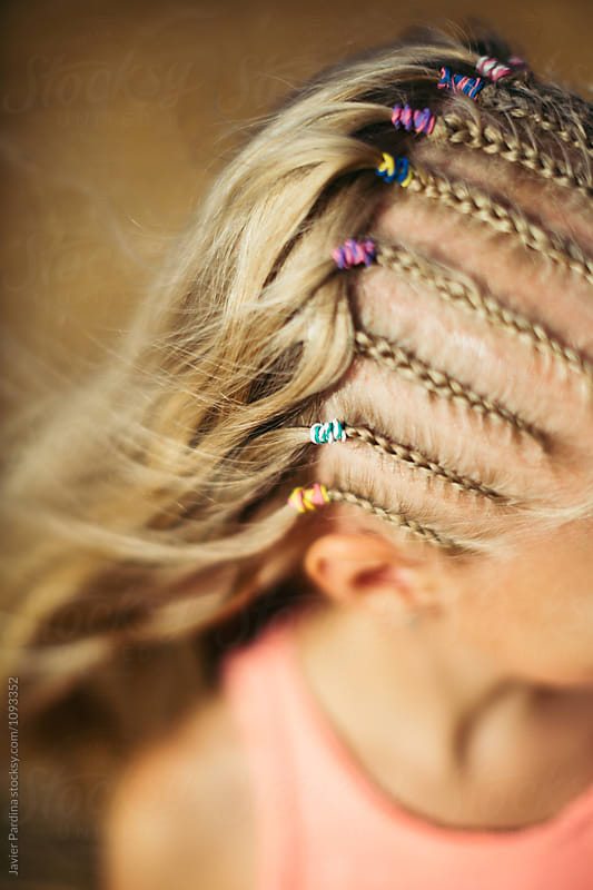 pigtails  on the child's  hair by Javier Pardina for Stocksy United