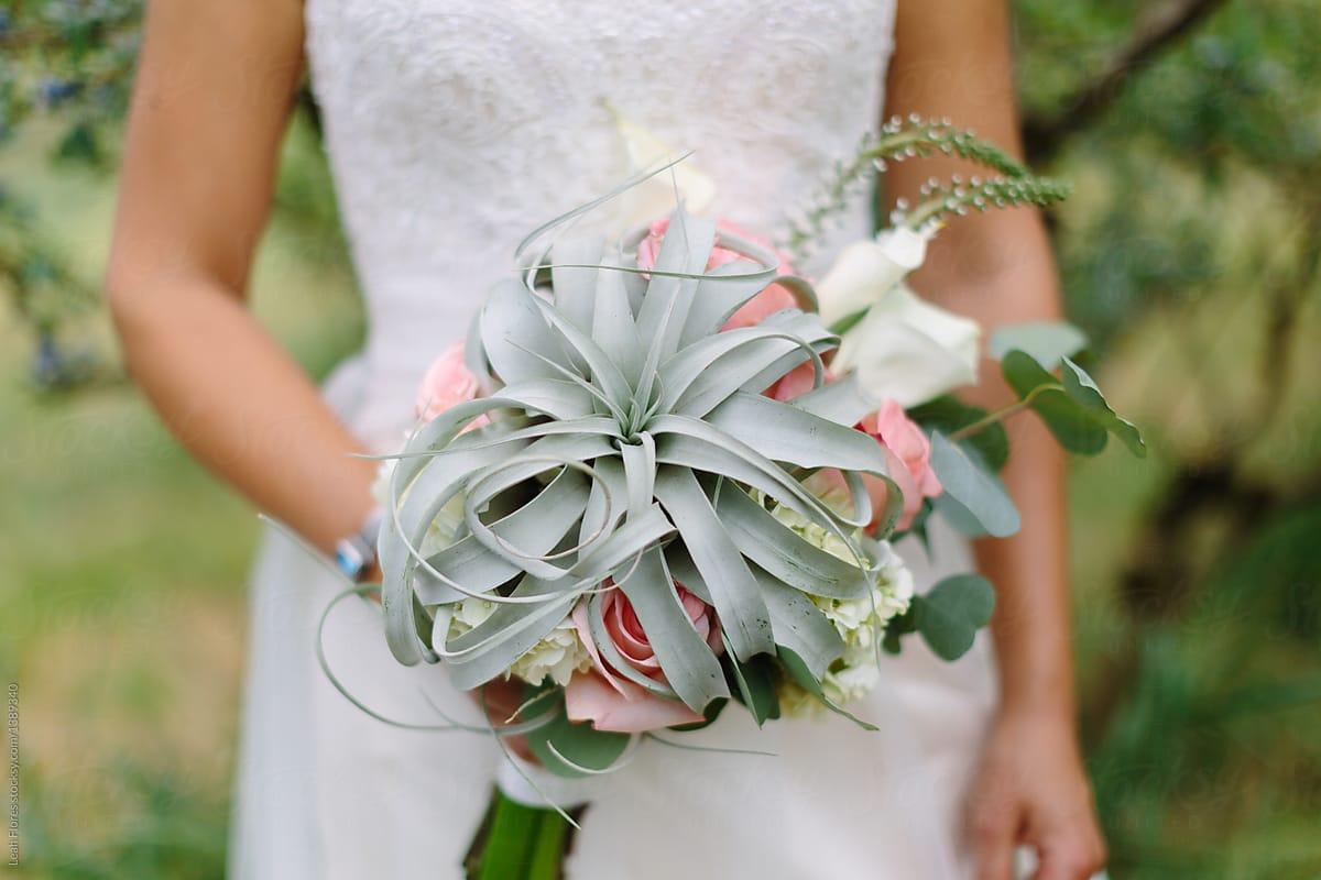 Bride Holding Air Plant Bouquet By Leah Flores Wedding Bouquet Stocksy United