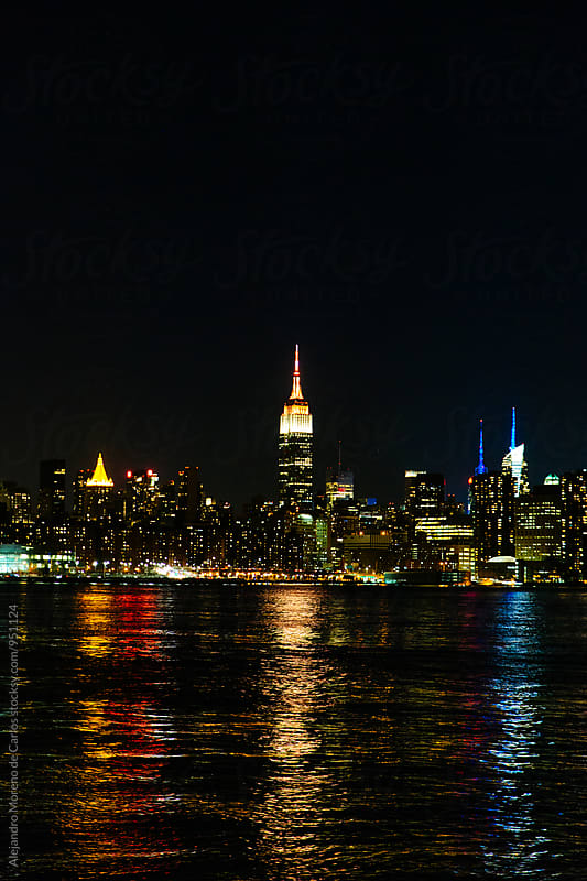 New York city at night over Hudson river by Alejandro Moreno de Carlos for Stocksy United