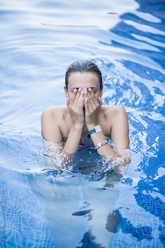 Woman in pool by Maja Topcagic for Stocksy United