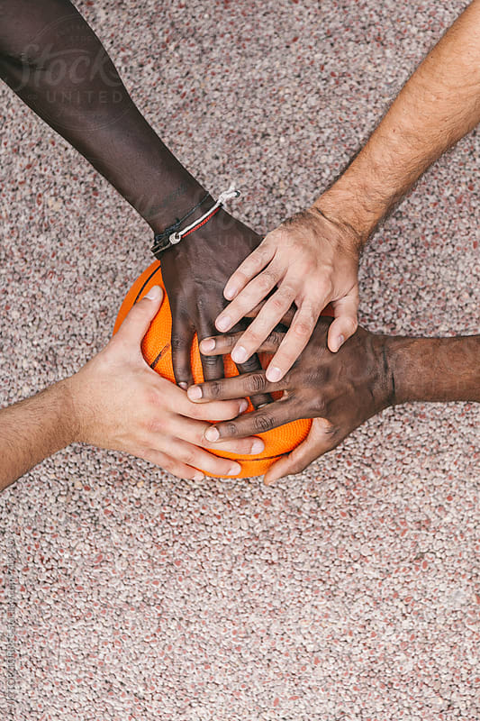 Four Multi-Ethnic Friends Stacking Hands by VICTOR TORRES for Stocksy United