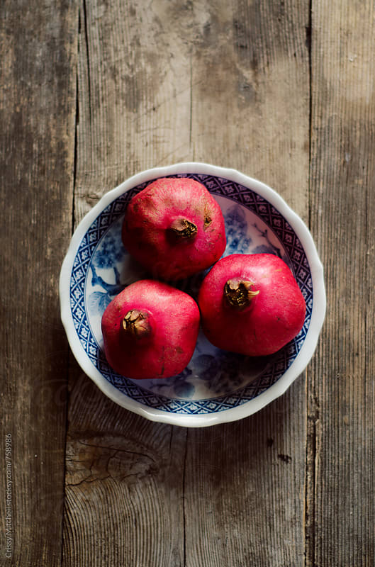 pomegranate  by Crissy Mitchell for Stocksy United