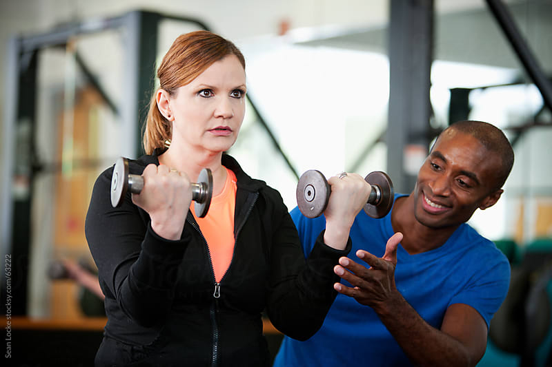 Gym: Mature Woman Works Out with Trainer by Sean Locke for Stocksy United