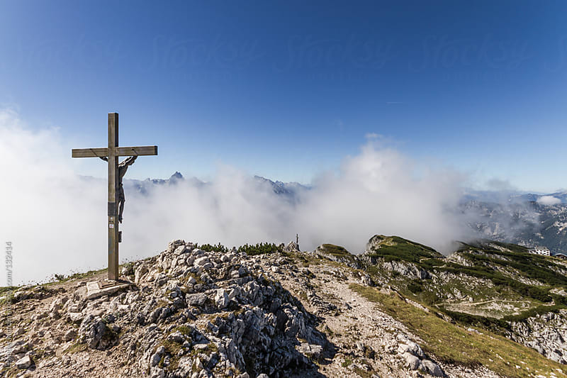summit cross in alpine landscape by Leander Nardin for Stocksy United