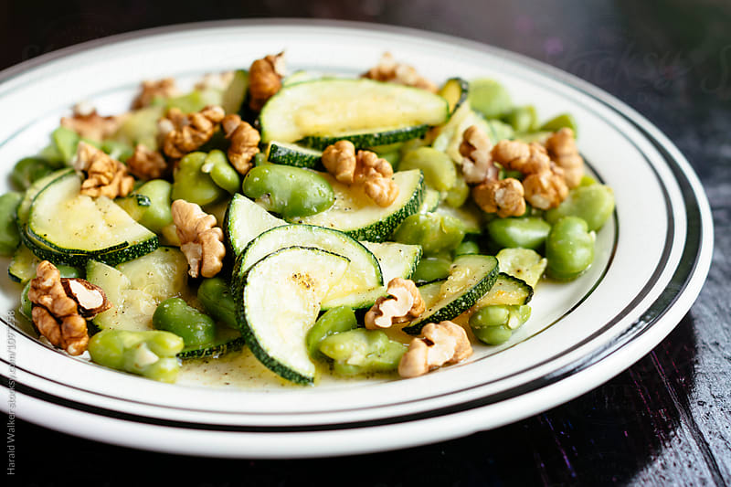 Warm Fava Bean and Zucchini Salad with Walnuts by Harald Walker for Stocksy United