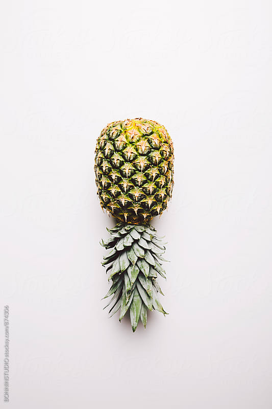 Pineapple isolated from above. by BONNINSTUDIO for Stocksy United