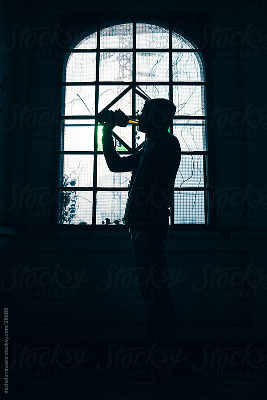 Silhouette of a man drinking. by michela ravasio for Stocksy United