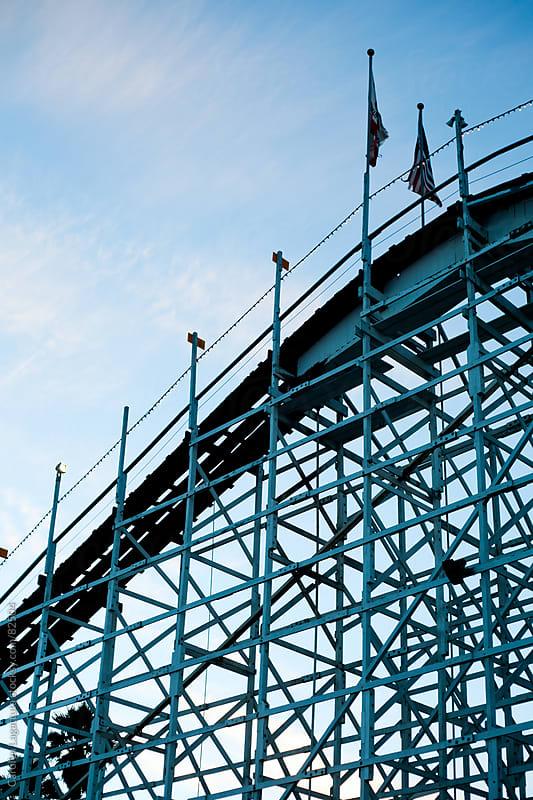 Roller coaster at the boardwalk as the sun goes down by Carolyn Lagattuta for Stocksy United