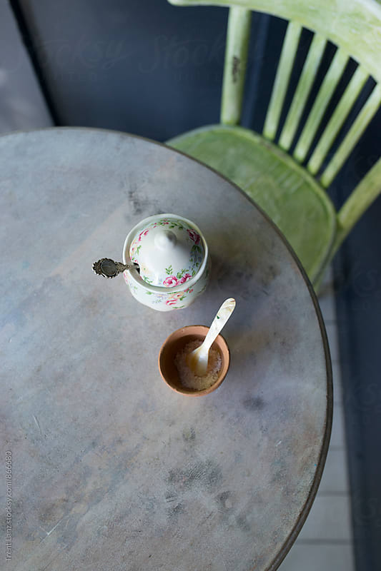 Close-up of sugar bowl and spoons for coffee and tea on old table by Trent Lanz for Stocksy United