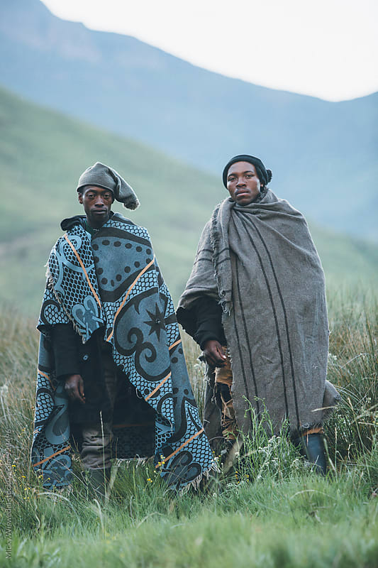 portrait of two Basotho herdsmen in the Lesotho highlands by Micky Wiswedel for Stocksy United