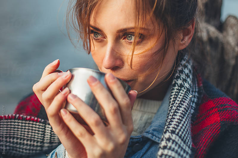 Woman holding hot drink by Dijana Tolicki for Stocksy United