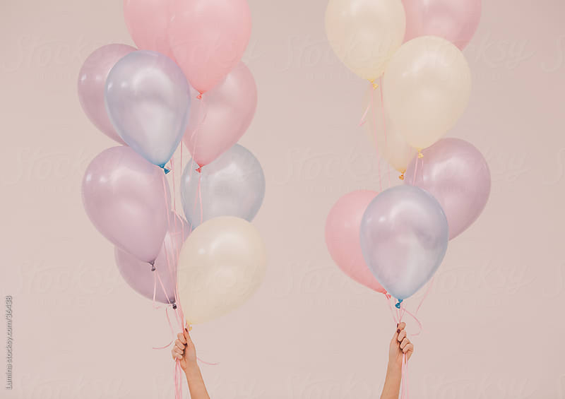 Hands Holding Balloons by Lumina for Stocksy United