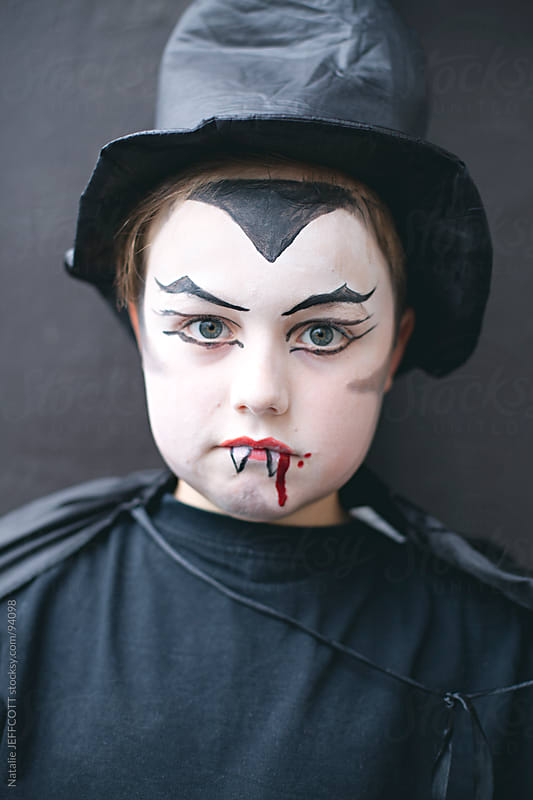 close up of boy dressed as vampire for Halloween by Natalie JEFFCOTT for Stocksy United